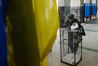 The first parliamentary (Verkhovna Rada) election in Ukraine since street protests ousted former Moscow-backed president Viktor Yanukovich. Citizens of Donetsk vote in one of the 1047 polling stations opened in the region. Oct. 26, 2014