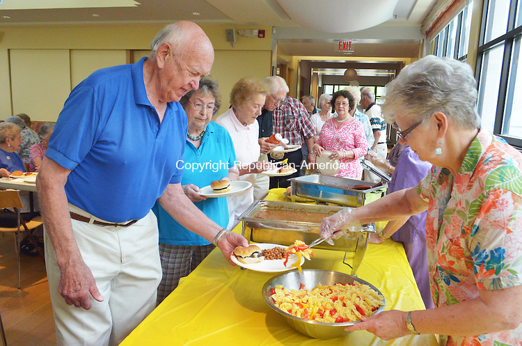 LITCHFIELD, CT- 18 July 2013 071813AP05- Joan Rinadli serves lunch to Vern Noad of Torrington at the Summer Party and Dance.  Alexandra Pape. Republican-American