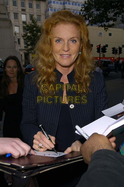 "SARAH FERGUSON, DUCHESS OF YORK.arrivals at book launch of ""Confessions of a Serial Womaniser"" by Zerbanoo Gifford, at the National Portrait Gallery..20th September London, England.half length fergie signing autographs autograph.CAP/CAN.©Can Nguyen/Capital Pictures"