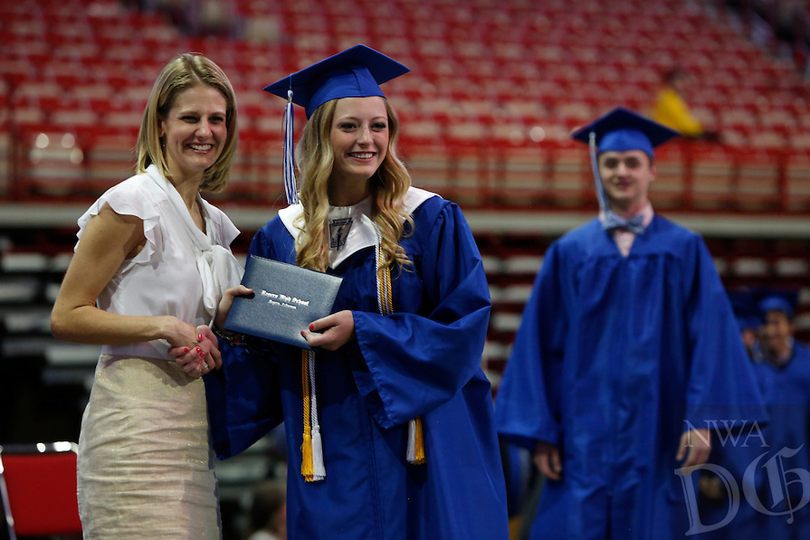 NWA Democrat-Gazette/DAVID GOTTSCHALK  Friday, May 20, 2016, the graduation ceremony of the 2016 class of Rogers High School at Bud Walton Arena in Fayetteville. Five hundred and one students graduated in the class.