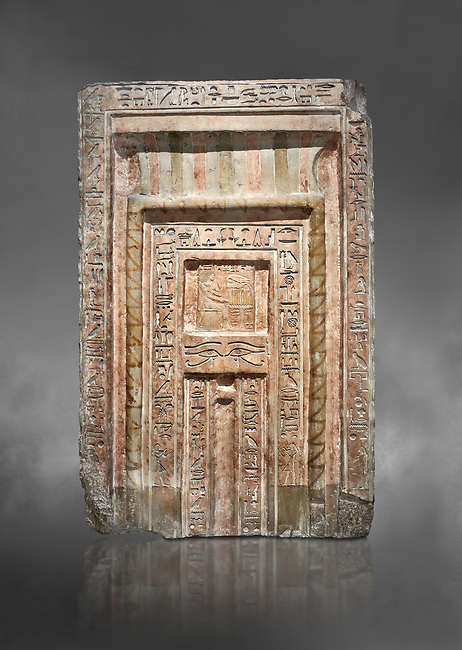 Ancient Egyptian False Door stele of Chamberlain Hornakht, son of Mera, slimestone, Middle Kingdom, 12th Dynasty (1939-1759 BC),  Egyptian Museum, Turin. Old fund cat 1612.  Grey background<br /> <br /> A false door is an artistic representation of a door which does not function like a real door. They can be carved in a wall or painted on it. They are a common architectural element in the tombs of ancient Egypt,