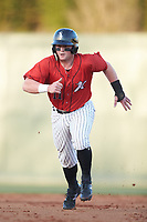 Evan Skoug (11) of the Kannapolis Intimidators takes off for third base against the Lakewood BlueClaws at Kannapolis Intimidators Stadium on April 5, 2018 in Kannapolis, North Carolina.  The Intimidators defeated the BlueClaws 4-3.  (Brian Westerholt/Four Seam Images)