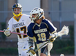 Tustin, CA 04/23/16 - Garrett DeLeon {La Costa Canyon #18) and Kostandinos Dalis (Foothill #47) in action during the non-conference CIF varsity lacrosse game between La Costa Canyon and Foothill at Tustin Union High School.  Foothill defeated La Costa Canyon 10-9 in sudden death overtime.