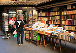 Books on display stalls outside book shop in Calle Mayor, Madrid city centre, Spain