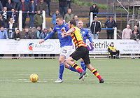 Stuart Bannigan pressuring Lyndon Dykes in the SPFL Ladbrokes Championship football match between Queen of the South and Partick Thistle at Palmerston Park, Dumfries on  4.5.19.