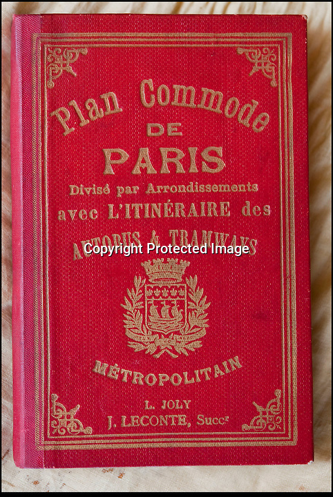 BNPS.co.uk (01202 558833)<br /> Pic: PhilYeomans/BNPS<br /> <br /> Unused Paris guidebook - The suitcase even contained his bag of personnel effect's send back from the front in 1916.<br /> <br /> Discovered in a loft - Poingnant reminder of families tragic loss during the Great War.<br /> <br /> A moving time capsule containing the last belongings of a dead soldier his family couldn't bring themselves to look at has been found in an attic after 98 years.<br /> <br /> The possessions of Private Edward Ambrose were sent home from the Western Front to his devastated parents after he was killed at the Somme.<br /> <br /> Too painful to look at, the poignant items were shut into a leather case and put into storage where they remained for almost a century.<br /> <br /> The case has now been opened by Pvt Ambrose's 82-year-old nephew who recovered it after reading about an appeal for untold stories for a local First World War exhibition.<br /> <br /> The effects include black and white photos of his loved ones, letters from his parents, his half-smoked pipe and a cigarette case with 10 roll-ups.