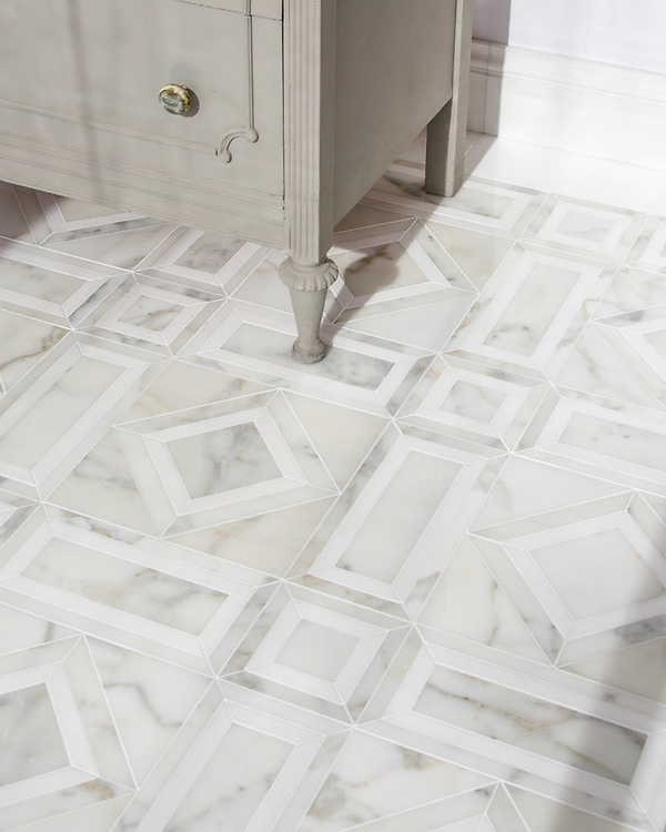 Lucius, a hand-cut stone mosaic, shown in polished Calacatta Tia and honed Thassos, is part of the Palazzo™ collection by New Ravenna.
