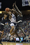 Nevada forward Jordan Caroline (24) shoots over the out stretched arm of San Diego State forward Aguek Arop (3) in the first half of an NCAA college basketball game in Reno, Nev., Saturday, Mar. 9, 2019. (AP Photo/Tom R. Smedes)