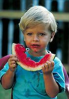 Delicious Little boy eating a slice of watermelon. Little boy. Douglaston NY.