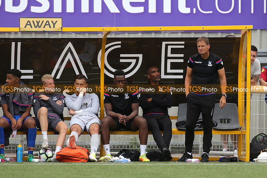 Crystal Palace Manager, Frank De Boer (standing) watches the match alongside his Assistant, Orlando Trustfull during Maidstone United vs Crystal Palace, Friendly Match Football at the Gallagher Stadium on 15th July 2017