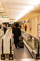 Hassidic Jews on moving sidewalk, Ben Gurion International Airport, Israel.