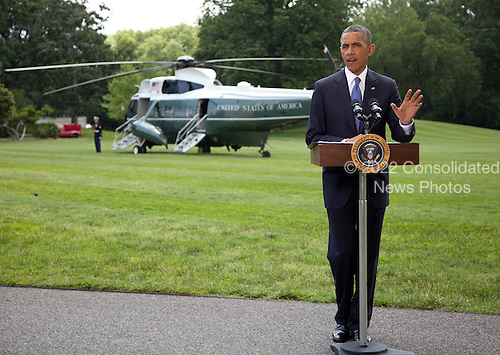 United States President Barack Obama makes a statement on the situation in Iraq prior to departing the South Lawn of the White House for a trip to North Dakota on Friday, June 13, 2014.  In his remarks the President said &quot;We will not be sending US troops back into combat in Iraq,&quot; but said he has asked his national security team for a &quot;range of options that he will be reviewing in the days ahead.&quot;<br /> Credit: Martin Simon / Pool via CNP