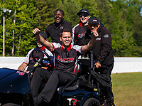 May 7, 2017; Commerce, GA, USA; Crew member Gary Pritchett (center) for NHRA top fuel driver Steve Torrence celebrates after winning the Southern Nationals at Atlanta Dragway. Mandatory Credit: Mark J. Rebilas-USA TODAY Sports
