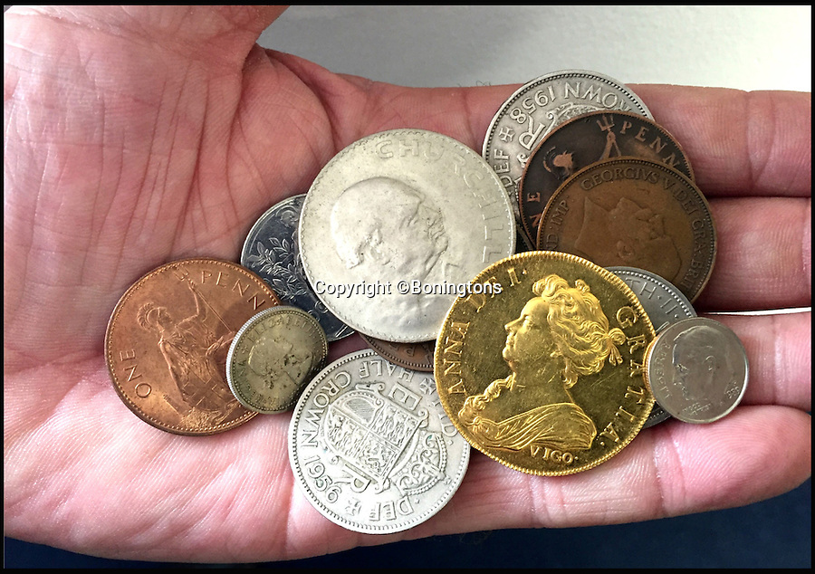 BNPS.co.uk (01202 558833)<br /> Pic: Boningtons/BNPS<br /> <br /> The coin was revealed to the amazed auctioneer in a handful of change from the vendors pocket.<br /> <br /> Shiver me timbers...A toy pirates treasure chest throws up real gold coin worth £250,000.<br /> <br /> A labourer is set to reap a life-changing £250,000 windfall after discovering the rarest British coin ever made - in his four-year-old son's toy treasure chest.<br /> <br /> The 35-year-old had been given the 'lost' 300 year old Queen Anne Vigo five guinea coin by his late grandfather 30 years ago to play pirate games with.<br /> <br /> After he bought his own son a treasure chest he dug the coin out and gave it to him to play with before having an auctioneer have a look at it.<br /> <br /> It is to be sold by Essex auctioneers Bonningtons.