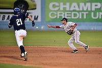 Greenville Drive second baseman Carlos Asuaje #20 starts the turn on a double play as David Dahl #21 runs to second during a game against the  Asheville Tourists at McCormick Field on May 17, 2014 in Asheville, North Carolina. The Tourists defeated the Drive 14-6. (Tony Farlow/Four Seam Images)