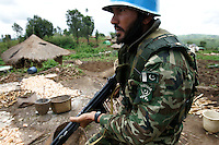 a Pakistanian MONUC UN peackeeper lands in the village of Liju after 30 militias left the site running on a sensiblizing operation with the aim to motivate the militias to volunterelly disarm in the eastern DRC Ituri region on March 25th 2005