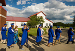WATERBURY, CT-062117JS04- Crosby graduates make their way down to the football field for graduation ceremonies on Wednesday. <br /> Jim Shannon Republican-American