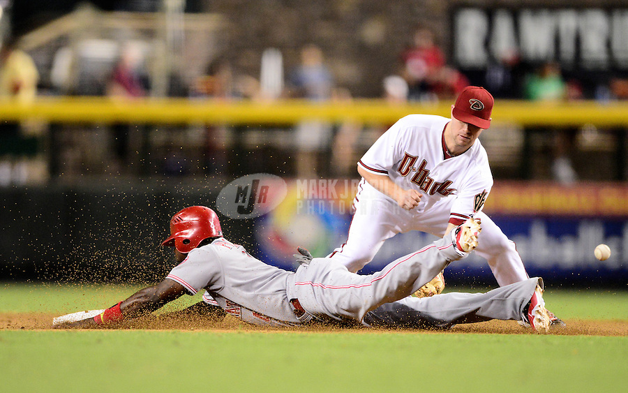 Aug. 28, 2012; Phoenix, AZ, USA: Cincinnati Reds base runner Brandon Phillips safely slides into second with a stolen base ahead of the tag by Arizona Diamondbacks second baseman Aaron Hill at Chase Field. Mandatory Credit: Mark J. Rebilas-