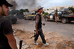 Young fighters went house to house, where they found six families taking shelter there because they didn't have any gas in their cars to get out, in the Seven Hundred neighborhood of Sirte, Libya, Oct. 7, 2011. Revolutionaries pressed in to Col. Muammar Gaddafi's hometown, encountering fierce resistance snipers, rocket-propelled grenades, and mortars.