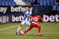 22nd June 2020; Estadio Municipal de Butarque, Madrid, Spain; La Liga Football, Club Deportivo Leganes versus Granada; Aitor Ruibal (CD Leganes) challenges for ball with Carlos Neva (Granada CF)
