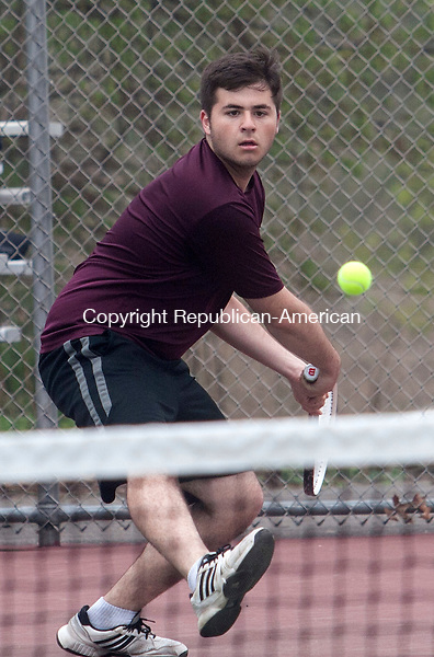 WOLCOTT, CT - 09 APRIL 2015 - 050915JW01.jpg -- Jake Gingold of Naugatuck returns against Wolcott Matt Spina  druring NVL match at Wolcott Saturday morning. Jonathan Wilcox Republican-American