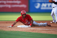 Palm Beach Cardinals center fielder Oscar Mercado (21) slides head first into third base during a game against the Jupiter Hammerheads on August 13, 2016 at Roger Dean Stadium in Jupiter, Florida.  Jupiter defeated Palm Beach 6-2.  (Mike Janes/Four Seam Images)