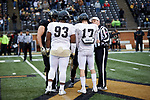 Zeek Rodney (93) and Alex Bachman (17) of the Wake Forest Gold Team meet with the of the Wake Forest Black Team captains prior to the start of the Wake Forest Football Spring Game at BB&T Field on April 7, 2018 in Winston-Salem, North Carolina.  The Gold Team defeated the Black Team 26-6.  (Brian Westerholt/Sports On Film)