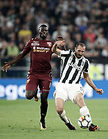 Calcio, Serie A: Torino, Allianz Stadium, 23 settembre 2017. <br /> Juventus' Giorgio Chiellini (r) in action with Torino's M'Baye Niang (l) during the Italian Serie A football match between Juventus and Tori0i at Torino's Allianz Stadium, September 23, 2017.<br /> UPDATE IMAGES PRESS/Isabella Bonotto