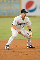 Third baseman Jake Smolinski #14 of the Jupiter Hammerheads on defense against the Charlotte Stone Crabs at Roger Dean Stadium June 15, 2010, in Jupiter, Florida.  Photo by Brian Westerholt /  Seam Images