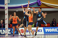 All Stars Monica Faulkner looks for a point as Aliyah Dunn (right) looks on during the Cadbury Netball Series match between NZ Men and All Stars at the Bruce Pullman Arena in Papakura, New Zealand on Friday, 28 June 2019. Photo: Dave Lintott / lintottphoto.co.nz