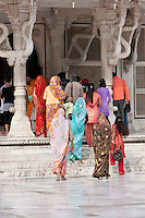 Fatehpur Sikri, Uttar Pradesh, India.  Women Entering the Mausoleum of Sheikh Salim Chishti, a 16th-century Holy Man Believed to be able to Assist Women Desiring to Conceive a Child.