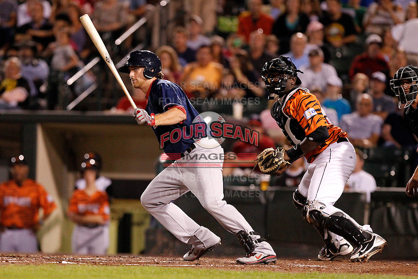 Pawtucket Red Sox third baseman Will Middlebrooks #24 at bat in front of catcher Jair Fernandez during a game against the Rochester Red Wings at Frontier Field on August 30, 2011 in Rochester, New York.  Rochester defeated Pawtucket 8-6.  (Mike Janes/Four Seam Images)