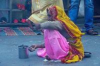 On the streets in Pushkar the day before Holi, poverty prevails, India