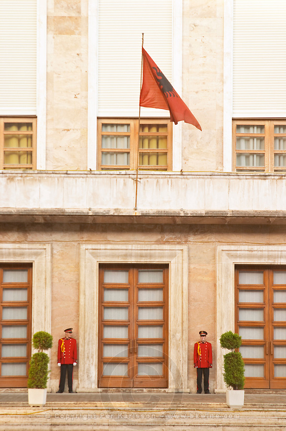 The presidential president's palace with Albanian flag and honour guard. On the boulevard Bulevardi Deshmoret e Kombit Tirana capital. Albania, Balkan, Europe.