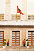 The presidential president's palace with Albanian flag and honour guard. On the boulevard Bulevardi Deshmoret e Kombit Tirana capital. Albania, Balkan, Europe.