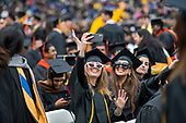 Amanda Inglesh, communications, and Katherine Elizabeth Kania, political science, during the procession of the University of Michigan spring commencement at Michigan Stadium in Ann Arbor, MI.