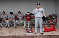 Starting pitcher Junichi Tazawa (13) of the Salem Red Sox waits out a rain delay by tossing a ball in the dugout prior to a game against the Potomac Nationals on June 16, 2011, at Pfitzner Stadium in Woodbridge, Va. Tazawa was on a Major League rehab assignment from the Boston Red Sox. (Tom Priddy/Four Seam Images)