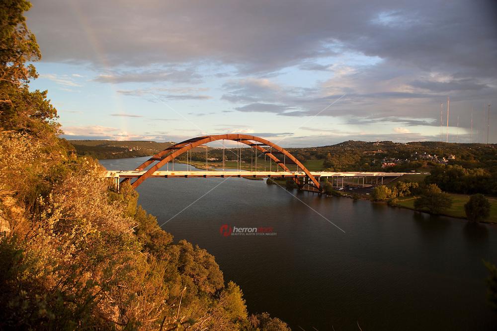A Rainbow overlooks the 360  Bridge (Pennybacker Bridge) surrounding hills and lake austin, Texas, USA