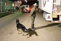 At a checkpoint north of Laredo, TX, a canine is used to find illegal aliens trying to cross into the US.
