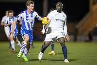 Adebayo Akinfenwa of Wycombe Wanderers & Cameron James of Colchester United during the Sky Bet League 2 match between Colchester United and Wycombe Wanderers at the Weston Homes Community Stadium, Colchester, England on 21 February 2017. Photo by Andy Rowland / PRiME Media Images.