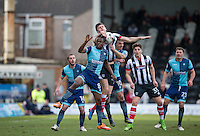 Calum Dyson of Grimsby Town gets a grip of Marcus Bean of Wycombe Wanderers during the Sky Bet League 2 match between Grimsby Town and Wycombe Wanderers at Blundell Park, Cleethorpes, England on 4 March 2017. Photo by Andy Rowland / PRiME Media Images.