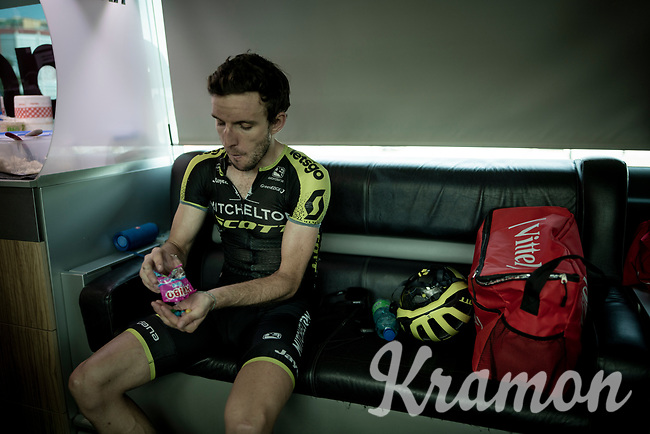 Simon Yates (GBR/Mitchelton-Scott) diving into a package of Haribo's on the teambus at the finish line in Nîmes<br /> <br /> Stage 16: Nîmes to Nîmes(177km)<br /> 106th Tour de France 2019 (2.UWT)<br /> <br /> ©kramon