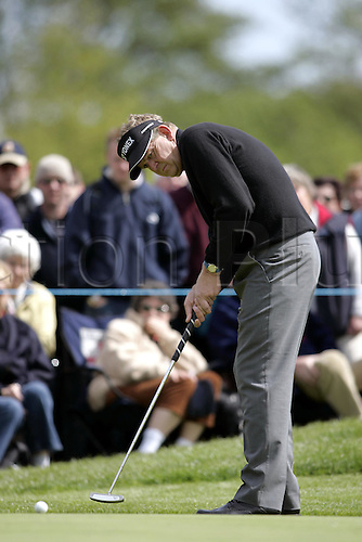 13 May 2005: Scottish golfer Colin Montgomerie putting during the second round of the The Daily Telegraph Dunlop Masters played at the Forest of Arden, Warwickshire. Photo: Neil Tingle/Actionplus..050513 golf golfer player gallery green