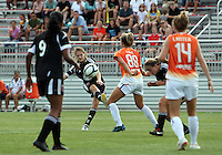 BOYDS, MARYLAND - July 22, 2012:  Ashley Herndon (19) of DC United Women slips the ball past Shelly Lyle (88) and Paige Lanter (14) of the Charlotte Lady Eagles during the W League Eastern Conference Championship match at Maryland Soccerplex, in Boyds, Maryland on July 22. DC United Women won 3-0.