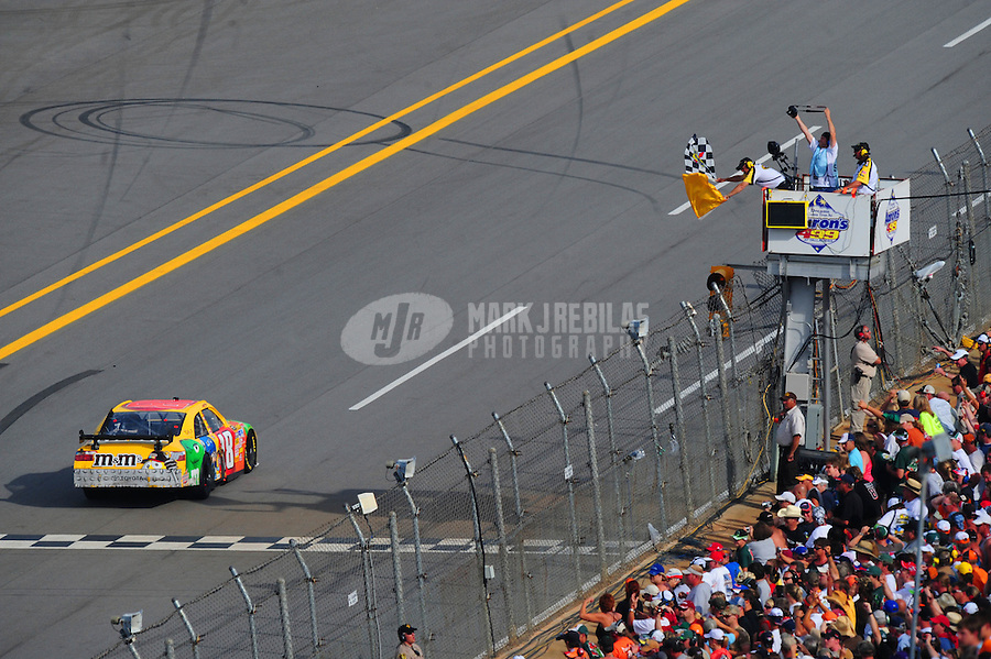 Apr 27, 2008; Talladega, AL, USA; NASCAR Sprint Cup Series driver Kyle Busch takes the checkered flag under caution to win the Aarons 499 at Talladega Superspeedway. Mandatory Credit: Mark J. Rebilas-