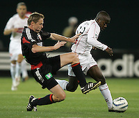 9 April 2005.   DC United midfielder Steve Guppy (7) tackles the ball away from Chicago Fire midfielder Thiago (29) at RFK Stadium in Washington, DC.