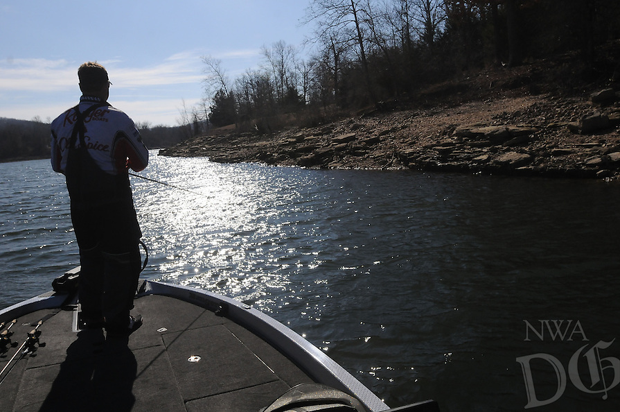 NWA Democrat-Gazette/FLIP PUTTHOFF <br /> Rocky banks hold crawdads which attract largemouth bass. Bohannan works a shoreline Jan. 27 2017 at Holiday Island on Table Rock Lake.