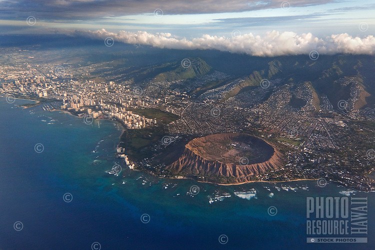 An aerial view of O'ahu's world-famous Diamond Head, surrounded by the Pacific Ocean, Waikiki and well-established neighborhoods.