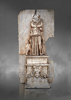 Roman Sebasteion relief sculpture of Ethnos of the Dacians Aphrodisias Museum, Aphrodisias, Turkey. Against a grey background.<br /> <br /> The Dacians are shown as a captive Barbarian woman. Her arms are crossed in submission, her thick dress slips off the shoulder slightly partly revealing her breast. The forepart of a small bull stands in profile behind. Dacia (modern Romania) was claimed by Augustus as a conquest in 1BC to 4AD
