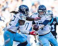 CHARLOTTE, NC - NOVEMBER 3: Ryan Tannehill #17 of the Tennessee Titans hands the ball off to Derrick Henry #22 during a game between Tennessee Titans and Carolina Panthers at Bank of America Stadium on November 3, 2019 in Charlotte, North Carolina.